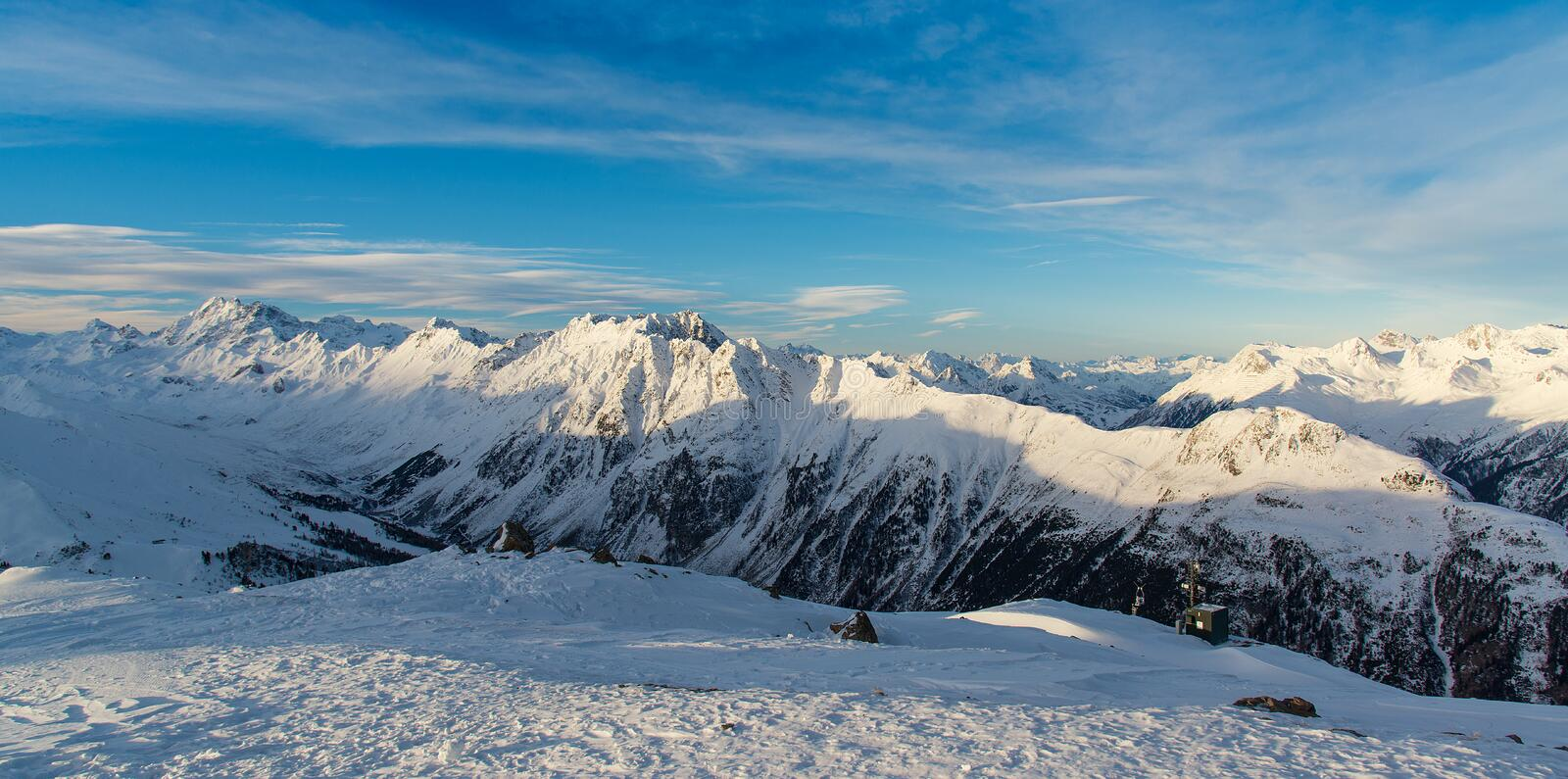 Panorama of the Alpine mountains in the evening at the ski resort of Ischgl, Austria. stock photos