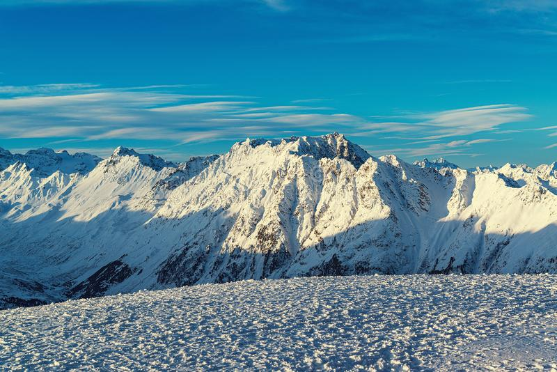 Panorama of the Alpine mountains in the evening at the ski resort of Ischgl, Austria.  royalty free stock photos