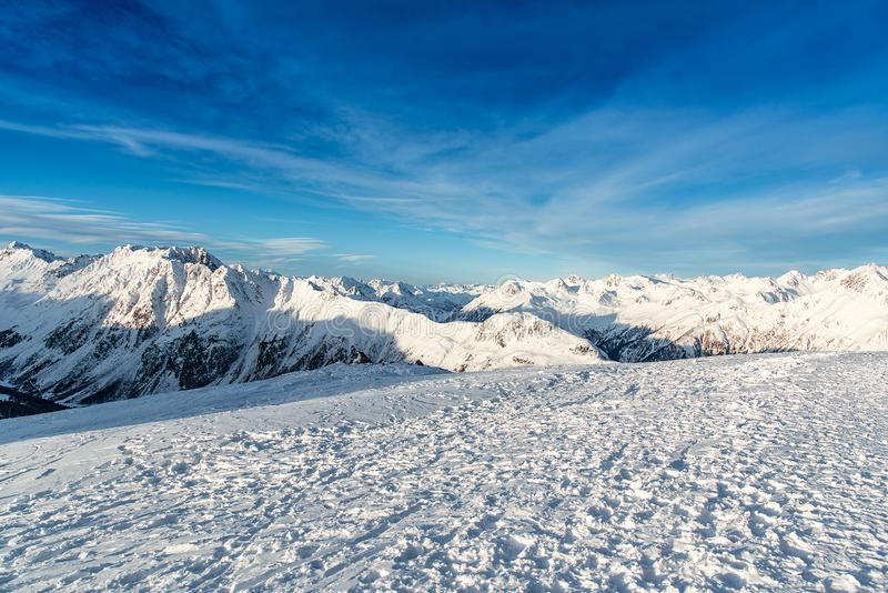 Panorama of the Alpine mountains in the evening at the ski resor royalty free stock photography