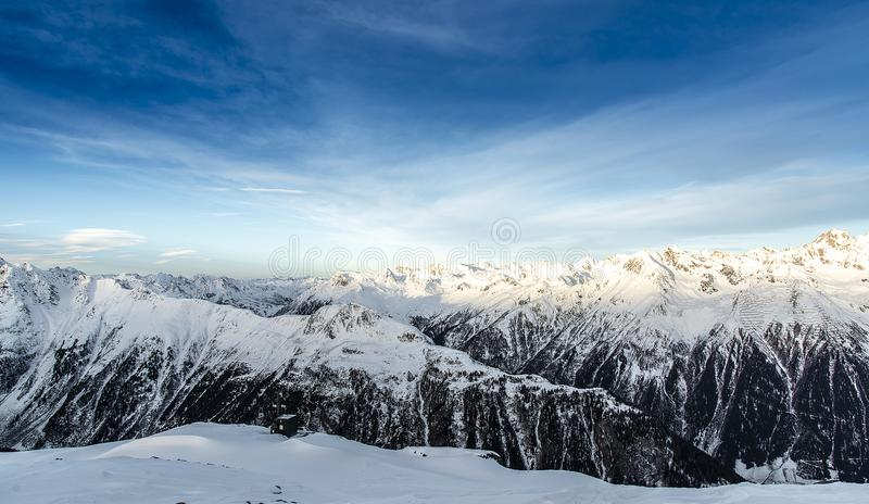 Panorama of the Alpine mountains in the morning at the ski resor stock image