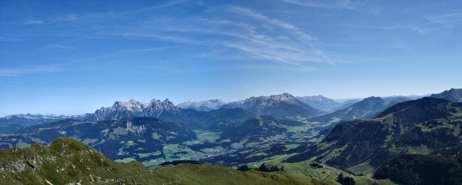 Panorama of the Alps. From Kitzbueheler Horn you have a wonderful view of the surrounding mountains: Loferer Steinberge , Watzmann and Hochkoenig . The Loferer royalty free stock photos