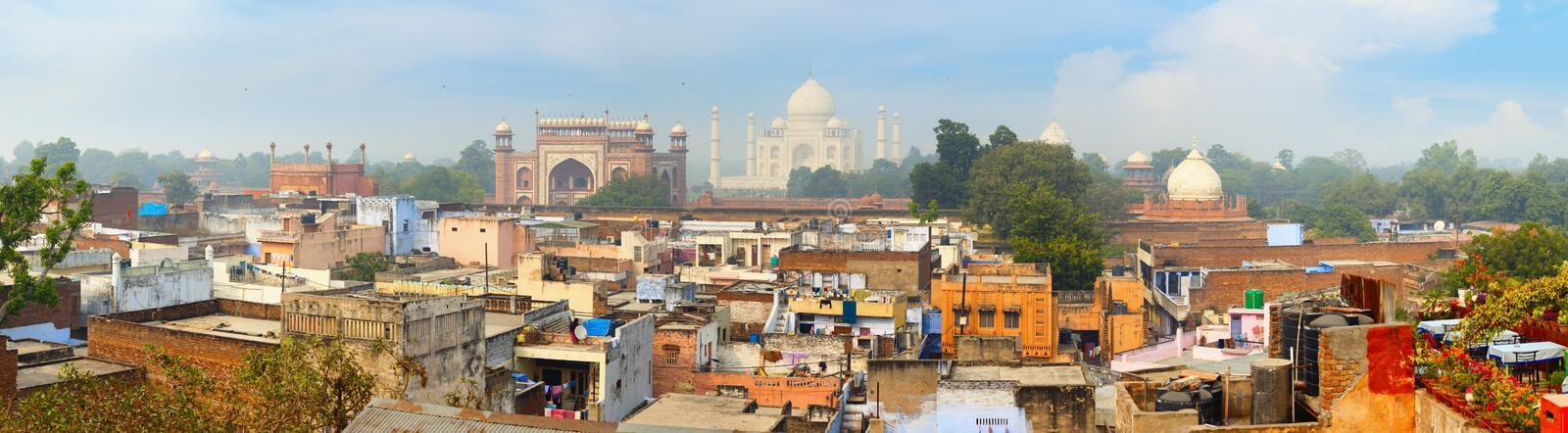 Panorama of the ancient Agra city. The famous mausoleum Taj Mahal in the background stock photo