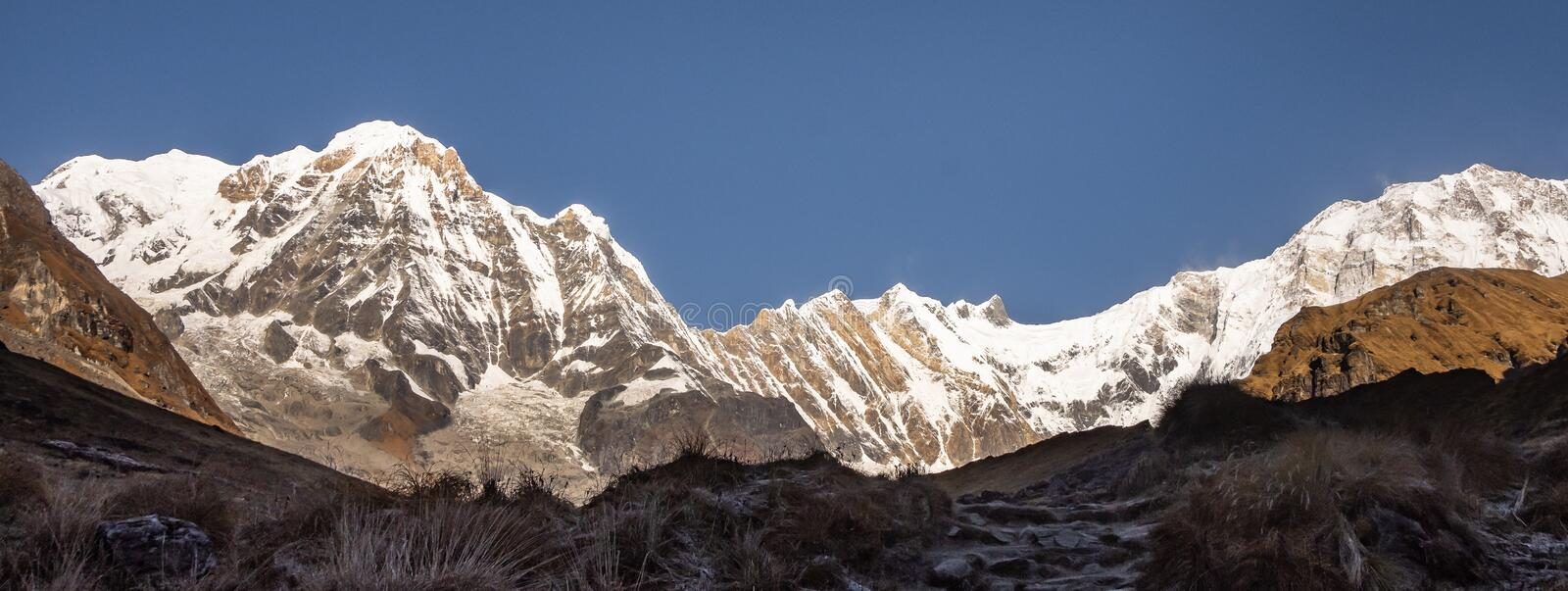 Panorama of Annapurna south and Annapurna 1 from Base Camp with clear blue sky, Himalayas royalty free stock photography