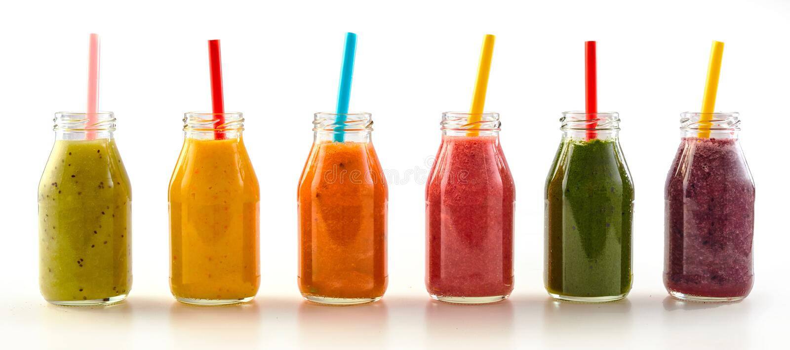 Panorama of assorted fresh fruit and veg smoothies royalty free stock images