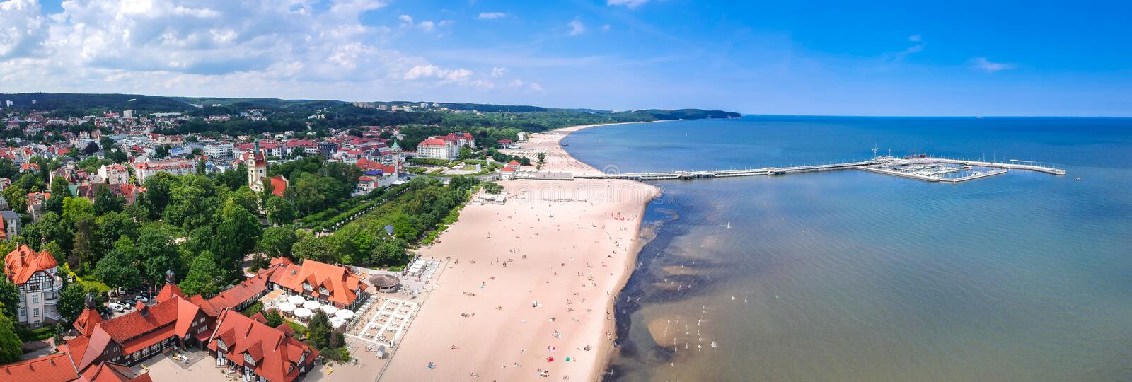 Panorama of the Baltic sea coastline with wooden pier in Sopot, Poland. Aerial, view, beach, vacation, molo, tourist, water, travel, promenade, europe stock photo