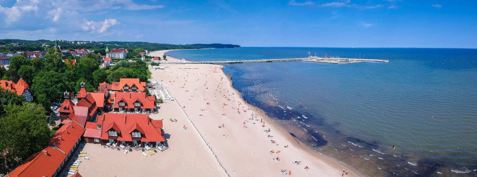 Panorama of the Baltic sea coastline with wooden pier in Sopot, Poland. Aerial, view, beach, vacation, molo, tourist, water, travel, promenade, europe royalty free stock photos