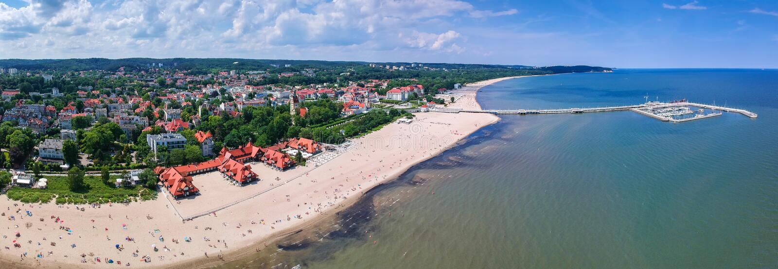 Panorama of the Baltic sea coastline with wooden pier in Sopot, Poland. Aerial, view, beach, vacation, molo, tourist, water, travel, promenade, europe royalty free stock image