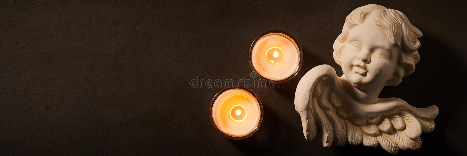 Panorama banner with burning candles and angel stock photography