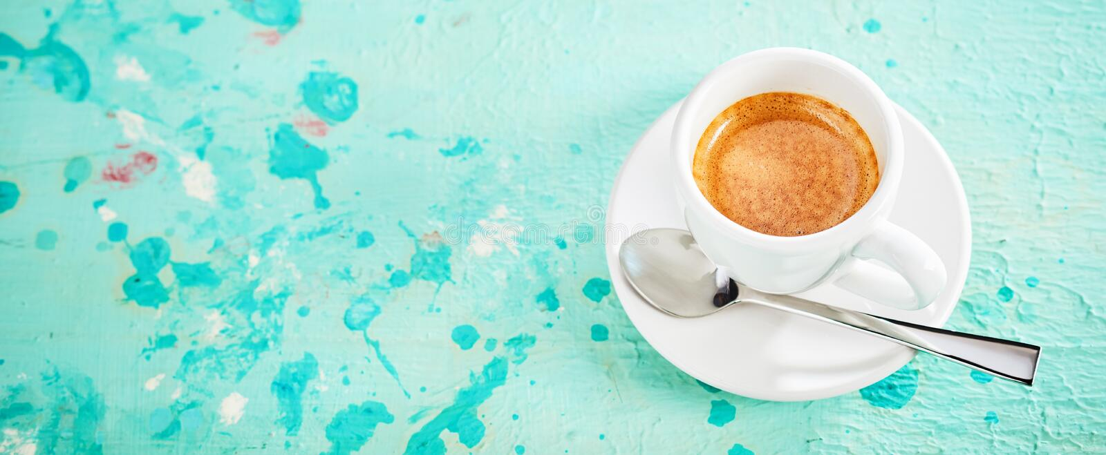 Panorama banner with cup of strong espresso coffee stock photography