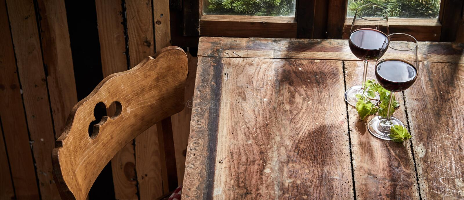 Panorama banner of red wine on a rustic bar table stock photography