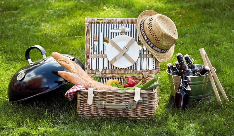 Panorama banner with vegetarian picnic hamper. Panorama banner with vegetarian or vegan picnic hamper filled with fresh salad ingredients, grapes and crusty royalty free stock photo