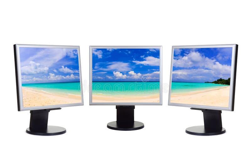 Panorama of beach on computer screens. Panorama of beach (my photo) on computer screens isolated on white background stock photography