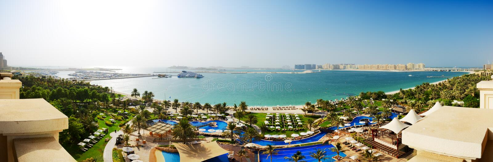Panorama of beach with a view on Jumeirah Palm man-made island. Dubai, UAE royalty free stock images