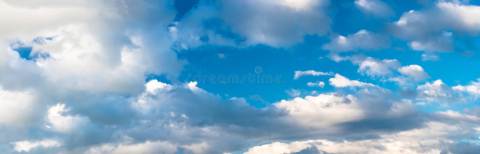 Panorama of beautiful blue sky with clouds on a hot summer day. High resolution stock photography