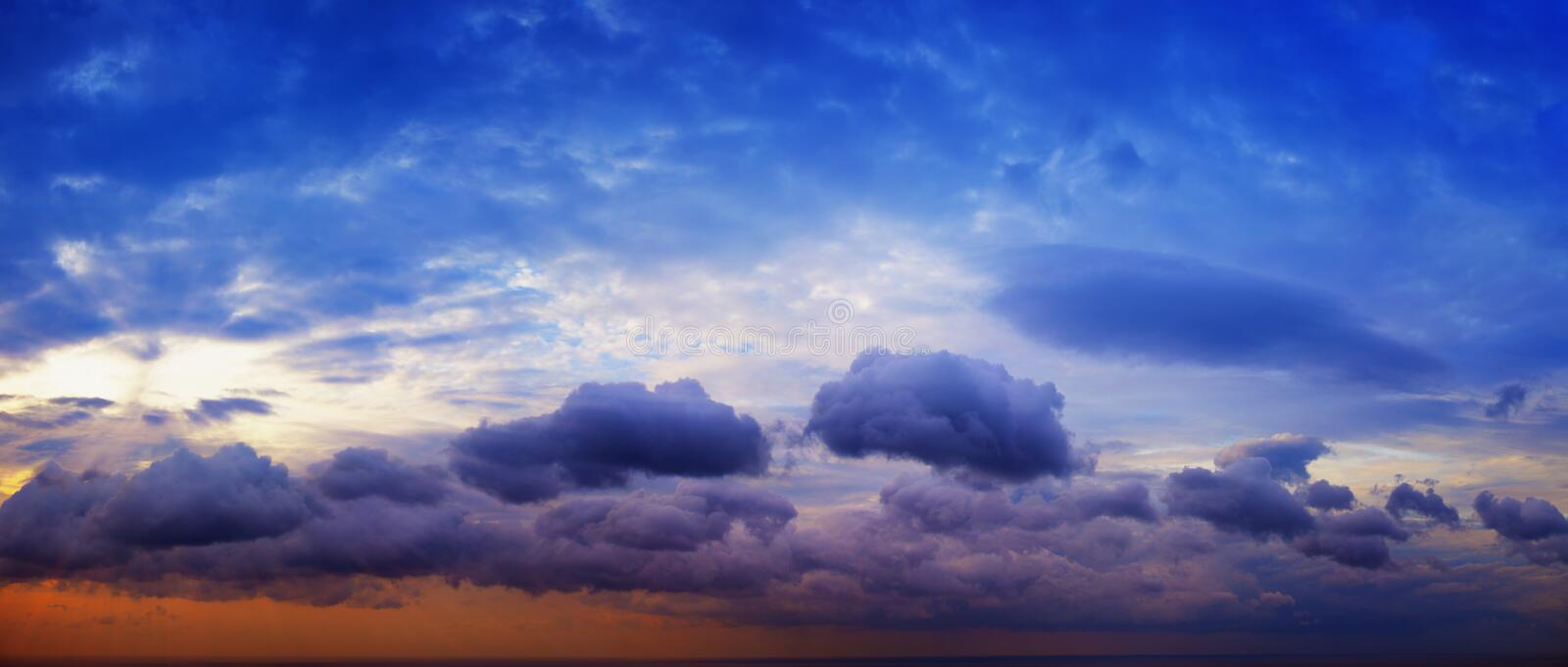 Panorama of beautiful cloudy sky with sunshine over the sea horizon stock images