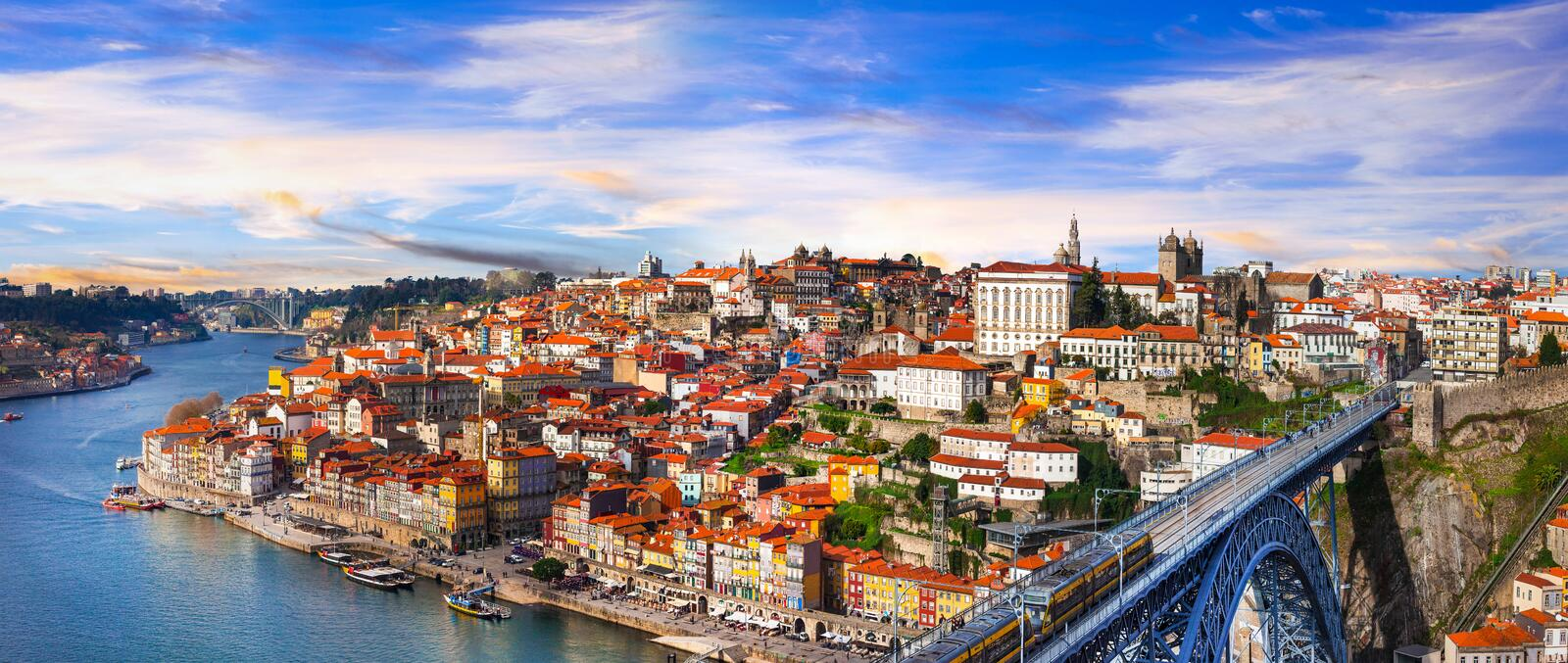 panorama of beautiful Porto over sunset - view with famous bridge of Luis, Portugal royalty free stock image