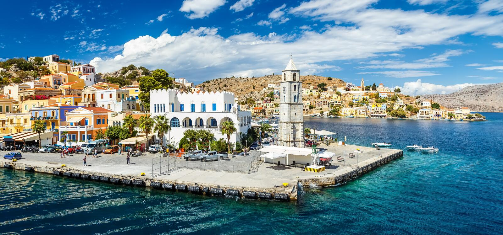 Panorama of beautiful summers day on the Greek island Symi in the Dodecanese Greece Europe. Beautiful summers day on the Greek island of Symi in the Dodecanese stock photos