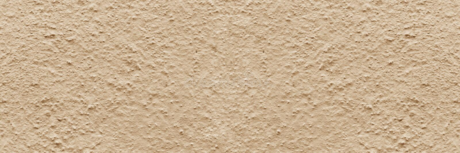 Panorama beige rough textured concrete background. copy space, text box, background for lettering, background for calligraphy royalty free stock photos