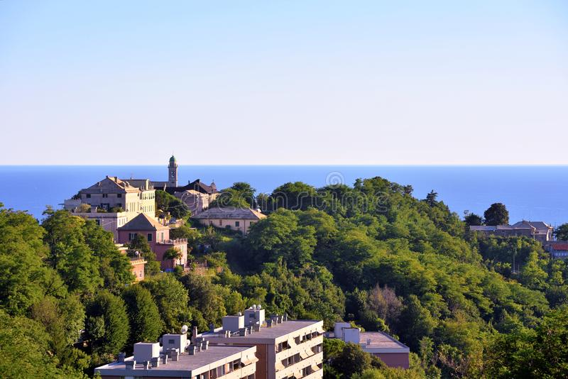 Genoa and the promontory church. Panorama from the belvedere of Genoa and the promontory church royalty free stock photo
