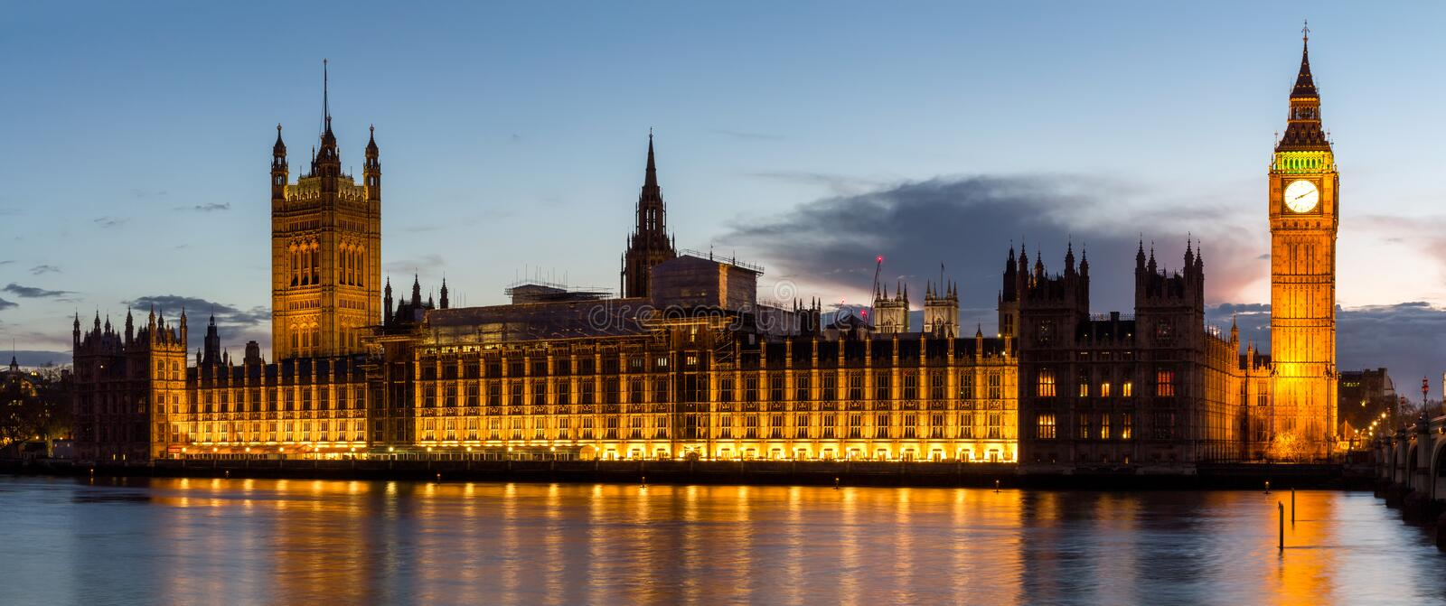 Panorama of Big Ben and House of Parliament at River Thames International Landmark of London England United Kingdom at Dusk royalty free stock photography