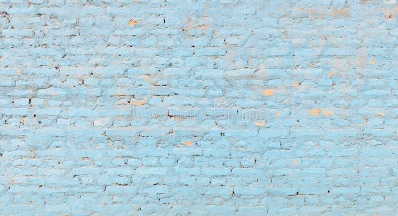 Panorama- blå tegelstenvägg arkivfoton
