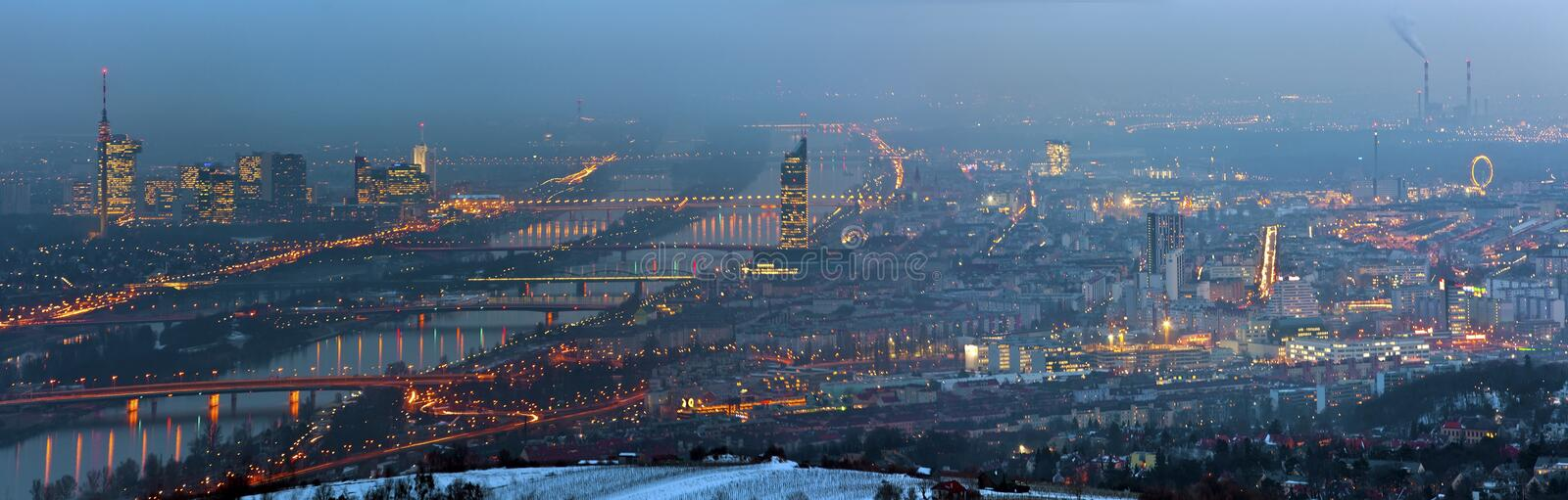 Panorama of blue danube vienna at foggy night in w royalty free stock photography
