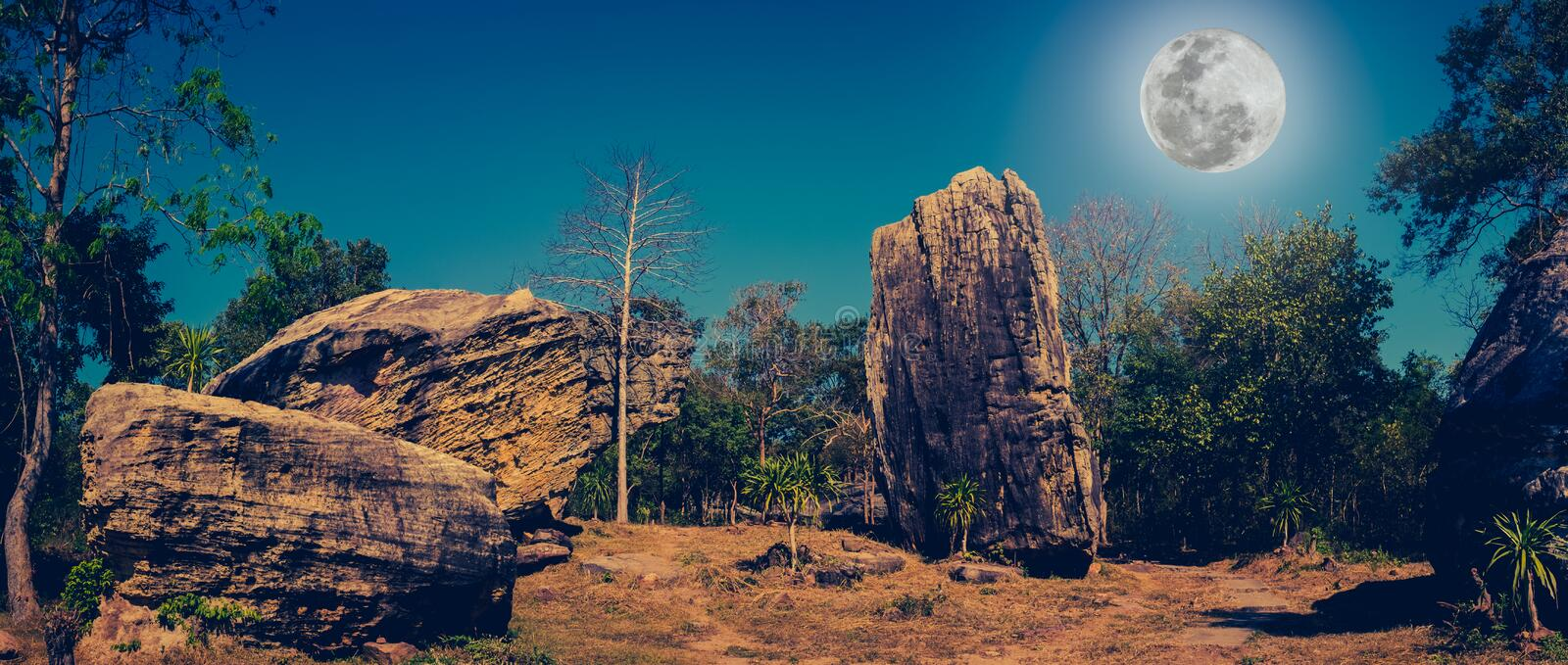 Panorama of boulders against beautiful sky and full moon over tr royalty free stock images