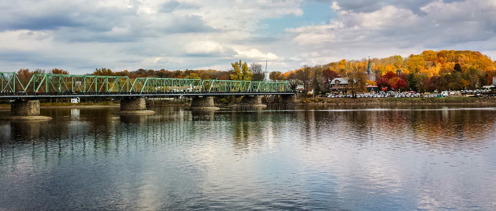 Panorama of bridge across Delaware River at New Hope, PA. Panorama of bridge across Delaware River to Lambertville, NJ from New Hope, PA in Autumn royalty free stock images