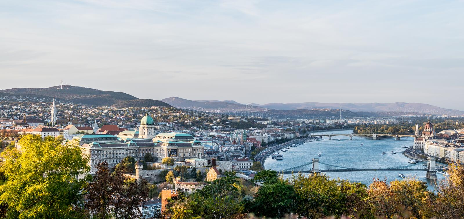 Panorama Buda Castle, Danube river and bridges, Parliament building stock photography