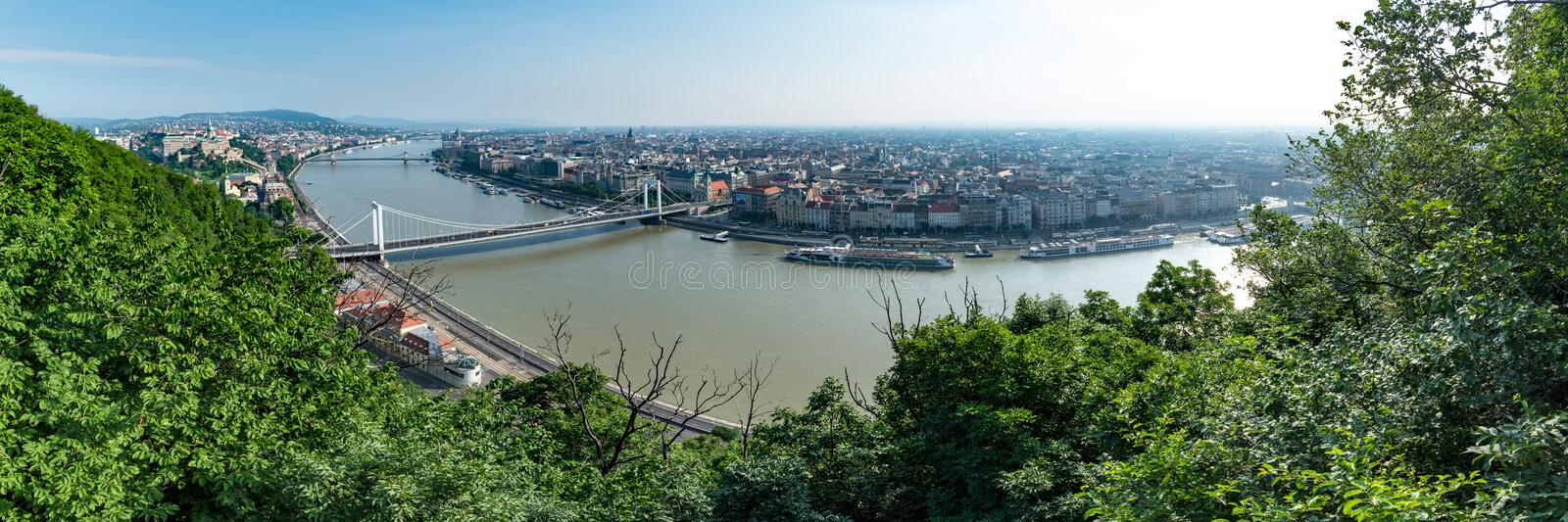 Panorama of Budapest on a bright hot morning, overlooking the river Danube and local landmarks royalty free stock images