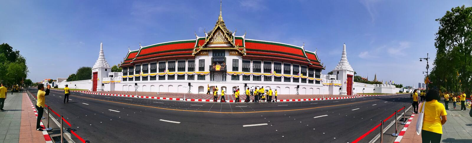 Panorama of Buddhaisawan Chapel and Thai in yellow shirtsin Bangkok during the moment of Thai Coronation days stock photography