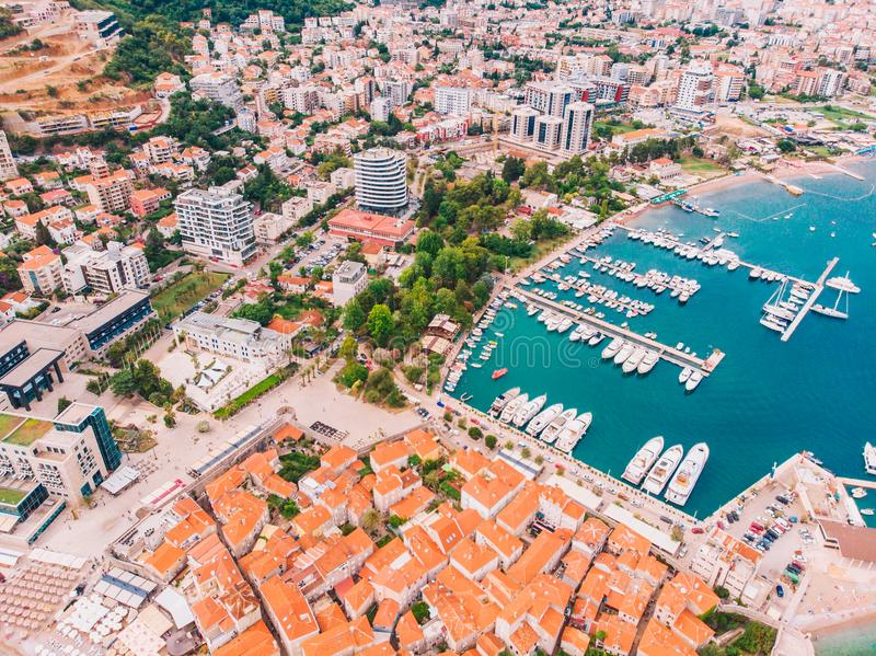 View from the air to the shore of Budva in Montenegro, summer day. Panorama of Budva in Montenegro on a sunny summer day, aerial view stock photography