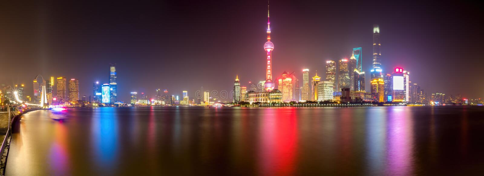 Panorama on The Bund - Shanghai City skyline by night royalty free stock images