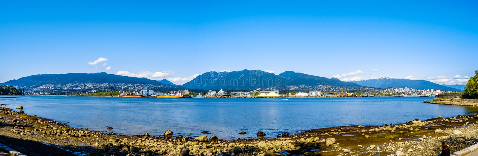 Panorama of the Burrard Inlet, the entrance into Vancouver Harbor, in beautiful BC, Canada royalty free stock image