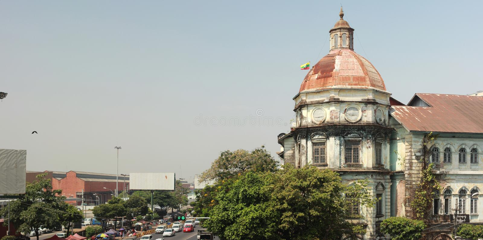 panorama of a busy street intersection in central Yangon, Myanmar, Southeast Asia royalty free stock image
