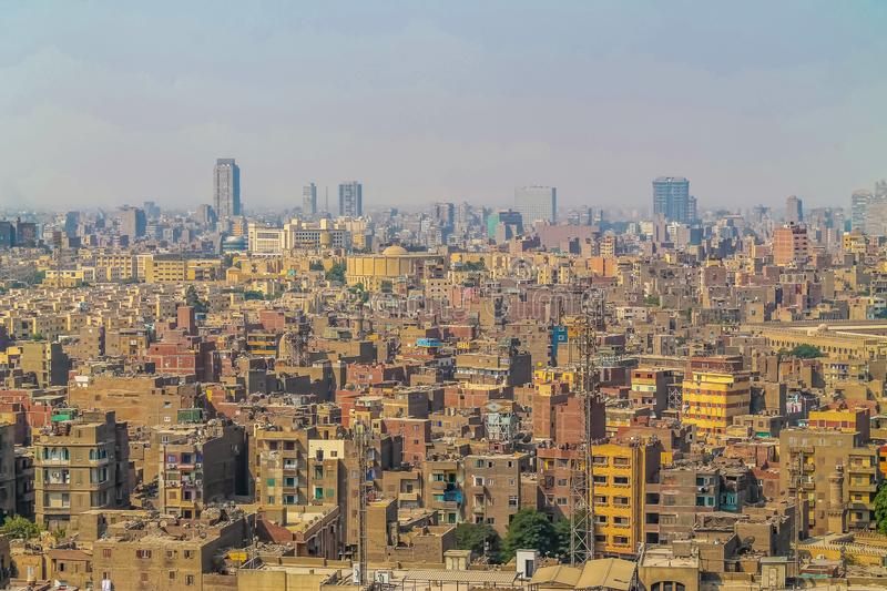 Panorama of Cairo overflowing with cars people and waste a huge population density. Cairo overflowing with cars people and waste a huge population density royalty free stock photo