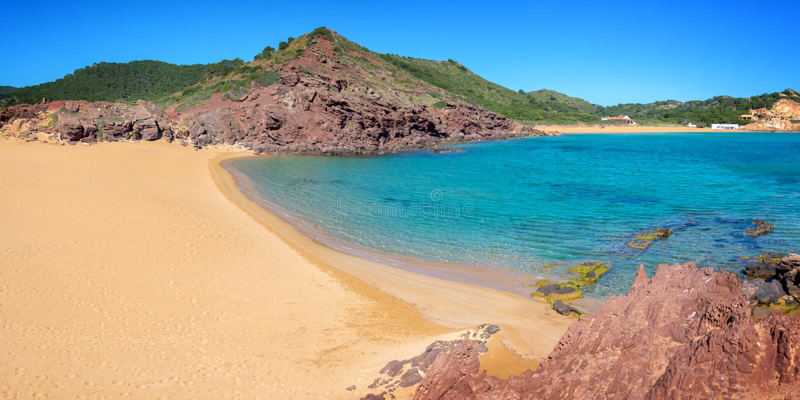 Panorama of Cala Pregonda beach in Menorca, Balearic islands Spain stock photos