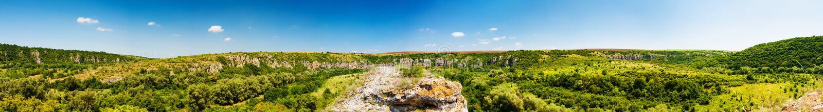 Panorama of the canyon of Rusenski Lom, Bulgaria. The wholes in the rocks are dwellings used as Hesychasm monastery stock photo