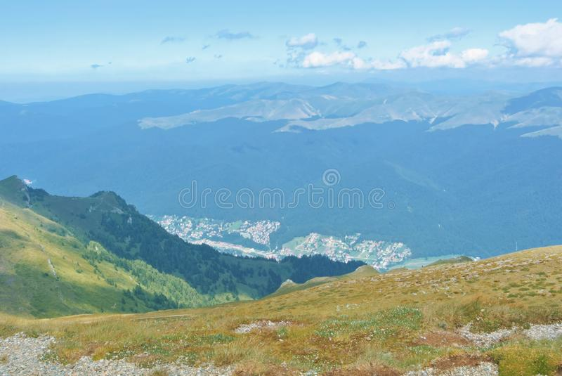 Panorama of Carpathian mountains scenery on summer autumn sunny. Day with a little village and a forest below stock photo
