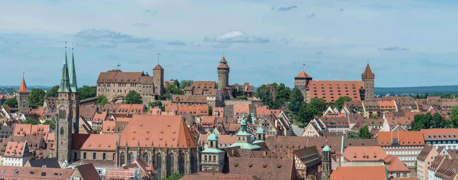 Panorama of the castle of Nuremberg and Sebaldus church on a sun royalty free stock photos