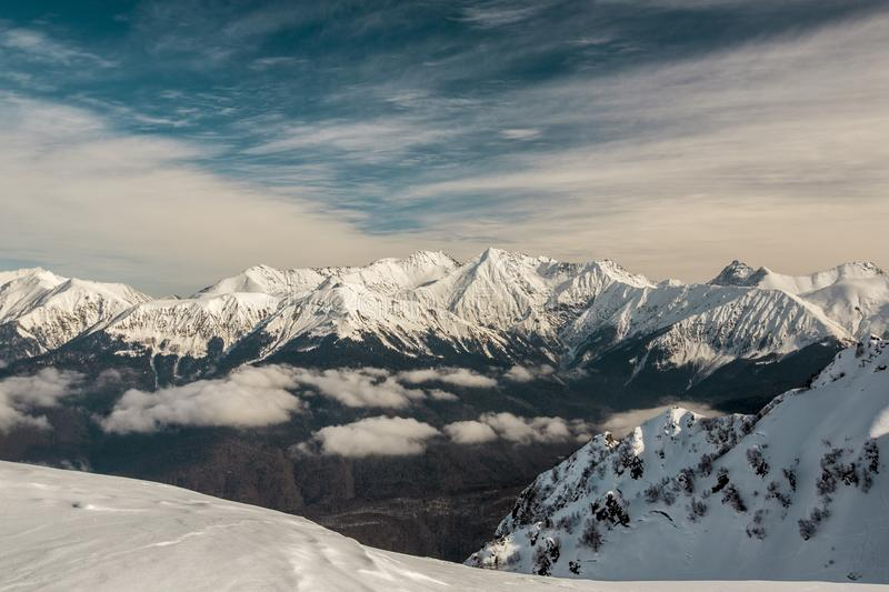 Panorama of the Caucasus mountain range with Ros Peak. In the direction of the southern slope. Panorama of the Caucasus mountain range with Rosa Peak. In the royalty free stock photos