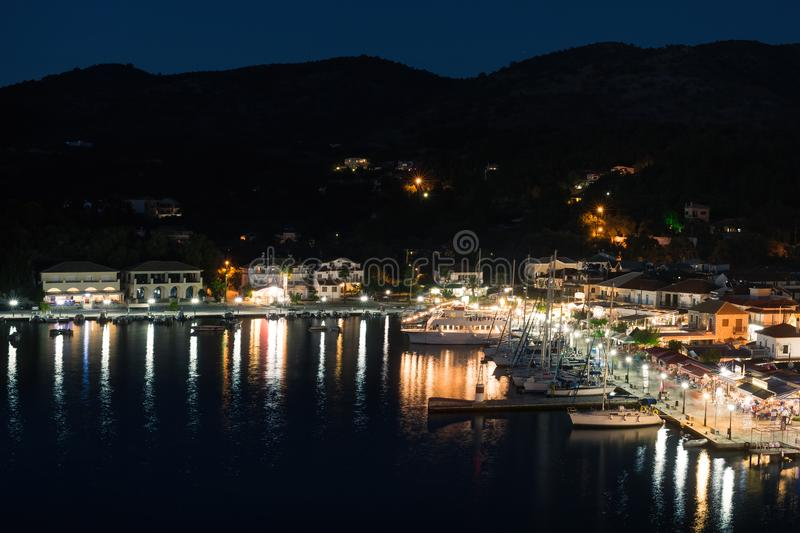 Panorama of the center of the night town of Sivota in the Greece. royalty free stock photo