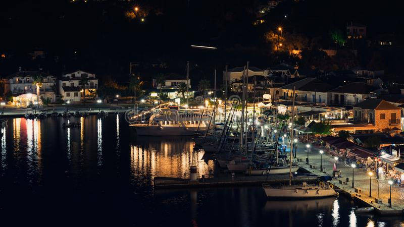 Panorama of the center of the night town of Sivota in the Greece. stock photography