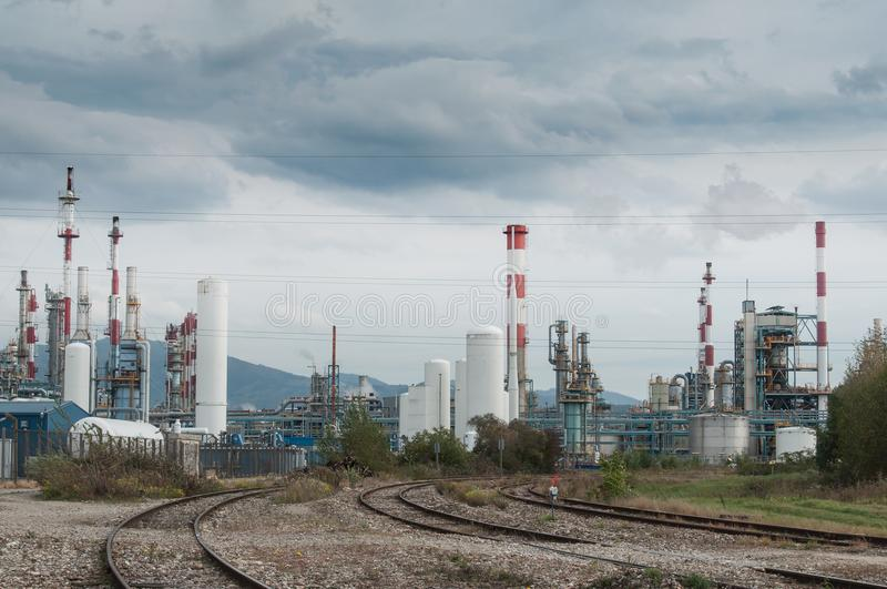 Panorama of chemical factory and railways. With cloudy sky royalty free stock images
