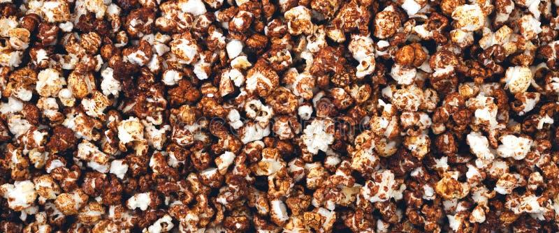 Panorama of chocolate popcorn stock image