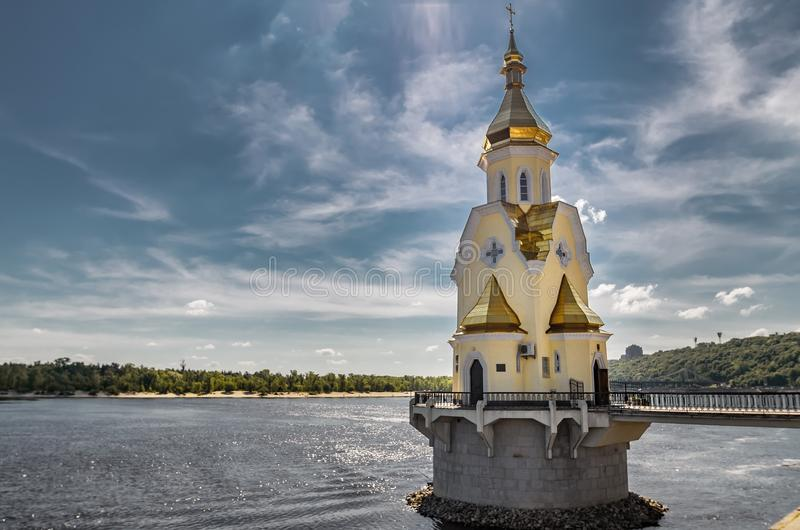 Panorama of the river dnepr with bridges and church at Kiev. Panorama of the city Kiev on summer day. St. Andrew`s Church stands on the Dnieper. Bridges across royalty free stock images