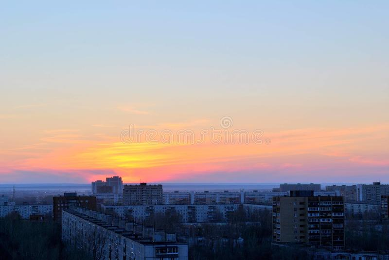 Panorama of the city and sunset sky from a bird's eye view. royalty free stock photography