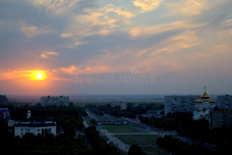 Panorama of the city of Tolyatti with a view of the Transfiguration Cathedral on the background of the sunset sky and clouds. Panorama of the city of Togliatti royalty free stock photo