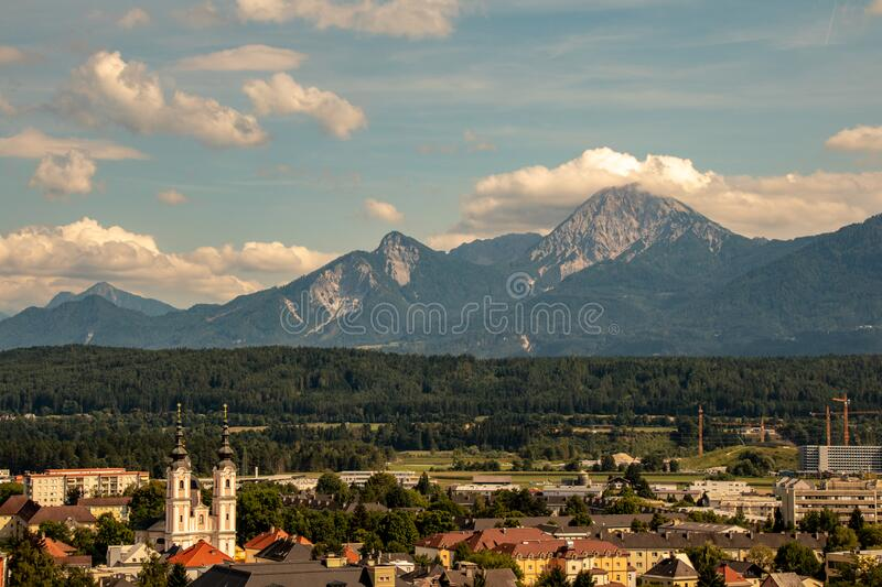 Panorama of the city of Villach with historical churches and a castle in front of the mountains of the Karawanken Mountains in the. Austrian Alps,Europe royalty free stock images