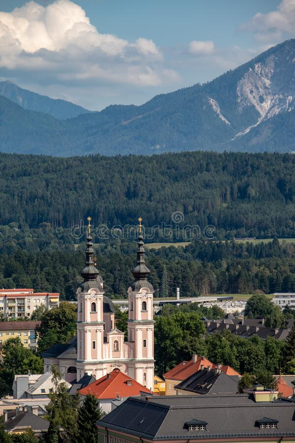 Panorama of the city of Villach with historical churches and a castle in front of the mountains of the Karawanken Mountains in the. Austrian Alps,Europe royalty free stock photo